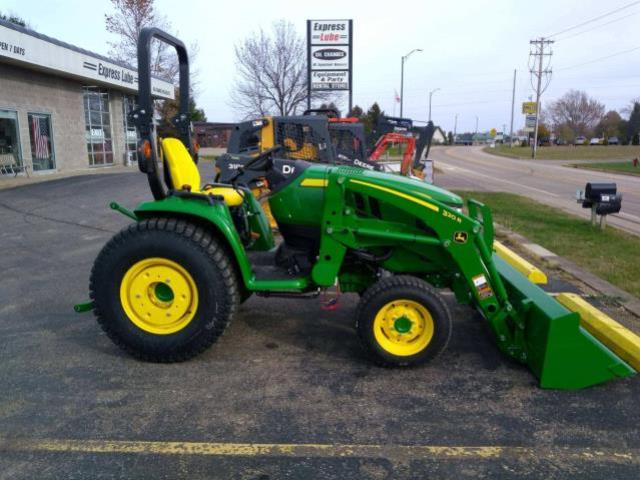 Where to find TRACTOR W LOADER in New Richmond